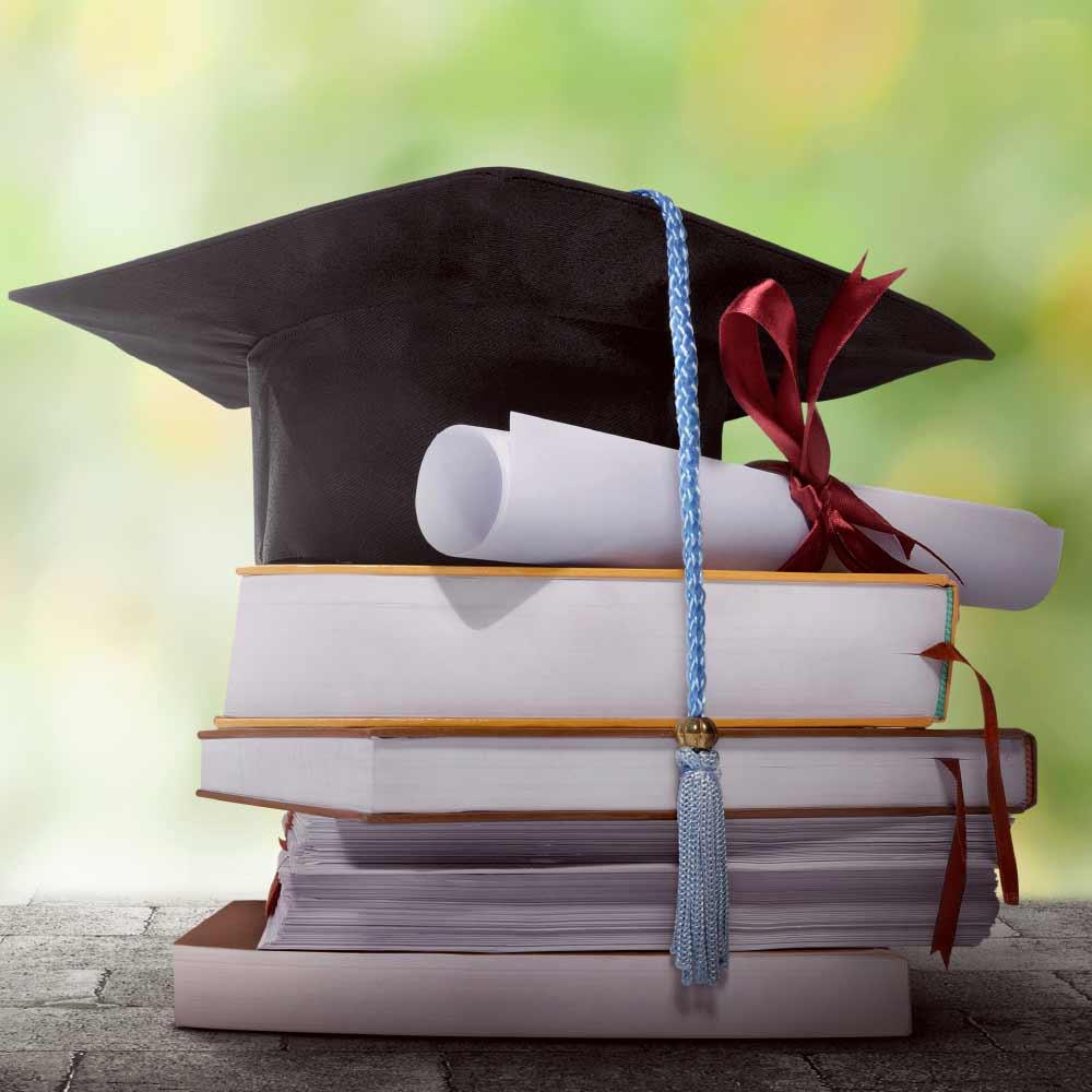 Grad Cap On Books